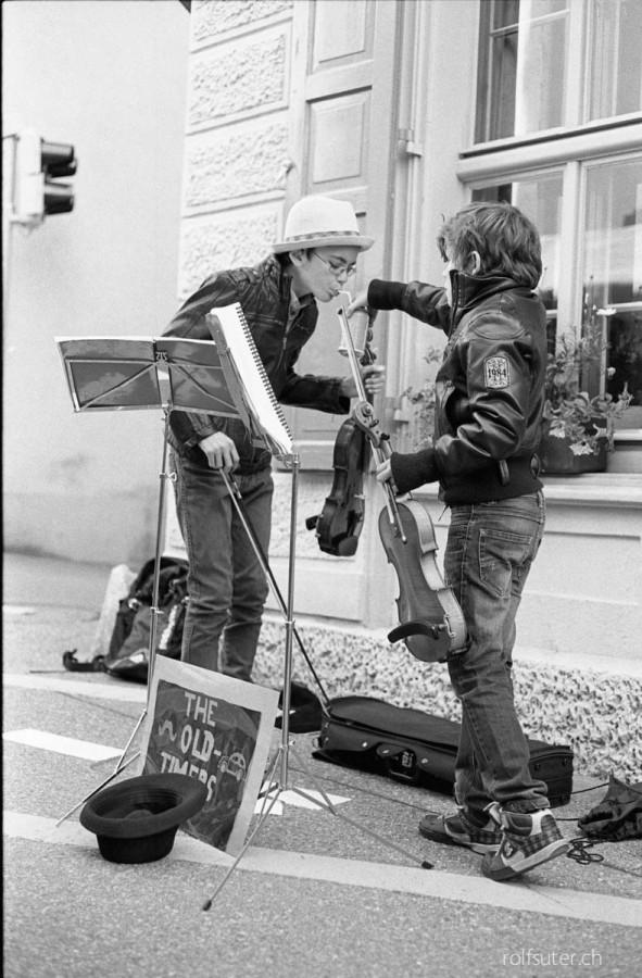 Drink, dear street musician, drink! Pontresina