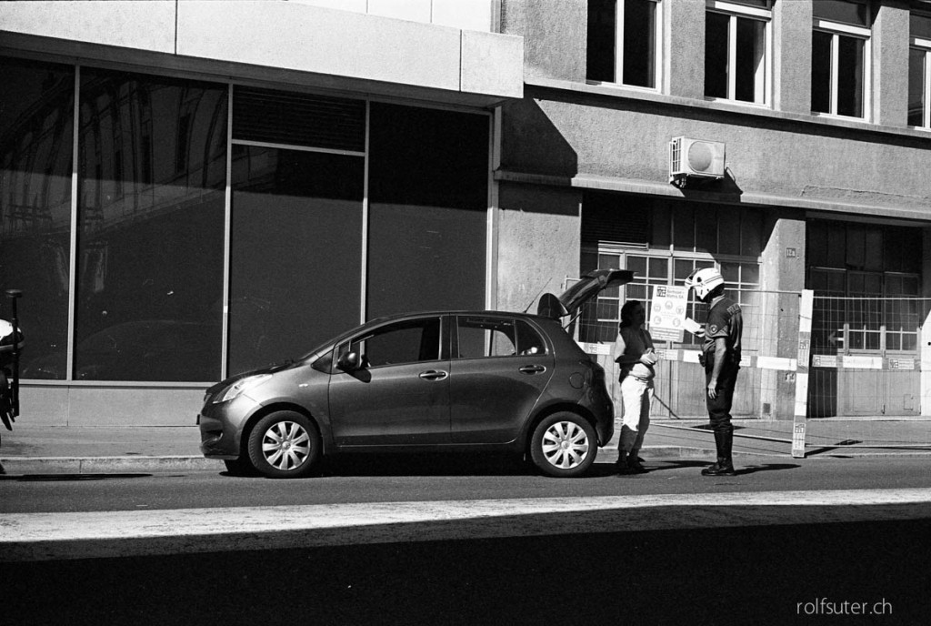 Policeman with helmet giving a fine, Lausanne
