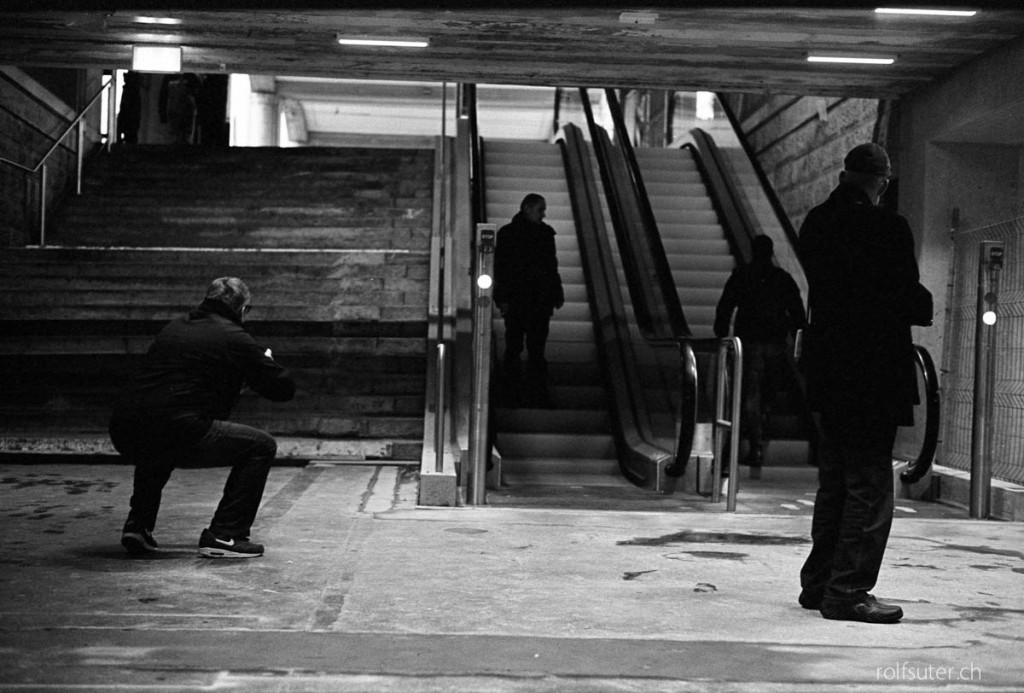 Photographer taking pictures  in the underpass at the train station in St. Gallen